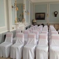 Chair covers with dusky pink sashes